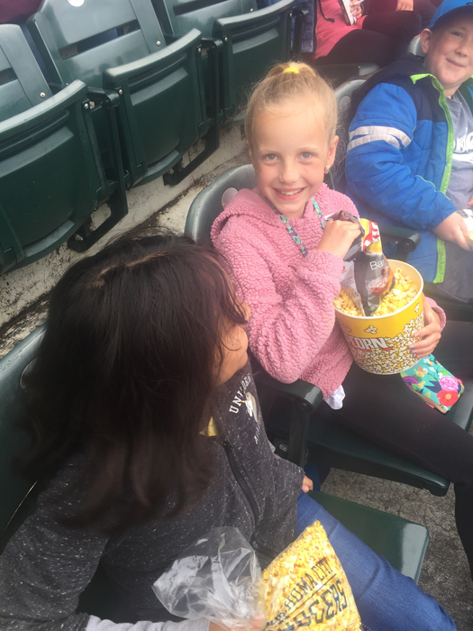 Hope is enjoying the ballgame snacks.